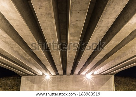 Overpass seen from below showing support column and beams - stock photo