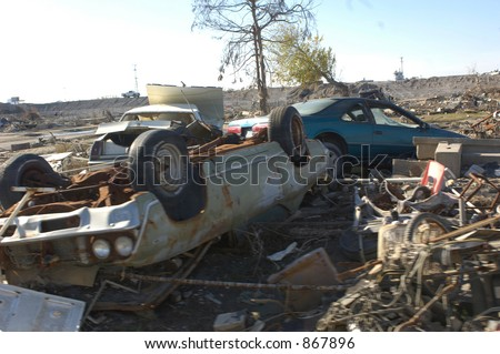 Overturned car amongst ruins in New Orleans, 9th Ward - stock photo