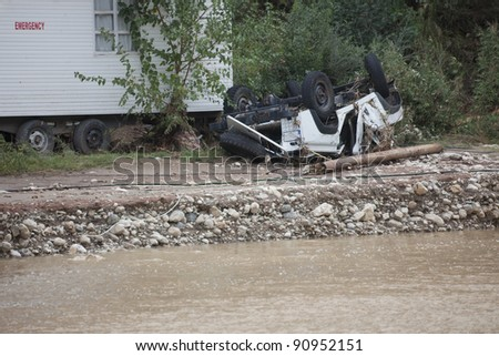 Overturned Car near Emergency Room - Flood Disaster in Olympos, Turkey, Asia - stock photo