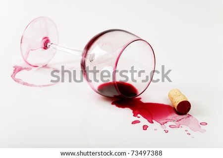 Overturned glass , poured wine and stains - stock photo