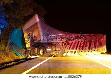 Overturned truck in crash. Night Photo - stock photo