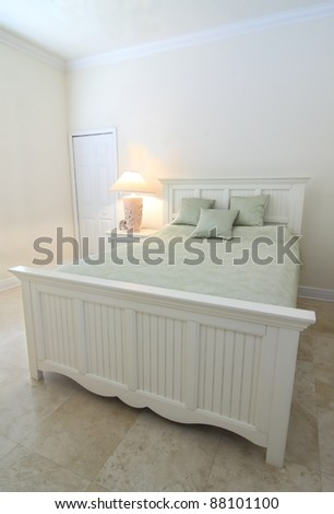 Overview of a beautiful contemporary  bedroom in a private residence with a travertine floor - stock photo