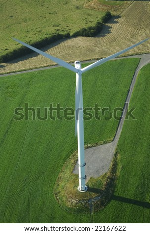 Overview of a lonely  windturbine in green meadow France Europe - stock photo