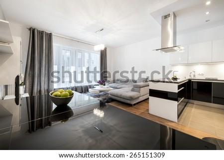 Overview of a modern  family room in a private residence with the open kitchen - stock photo