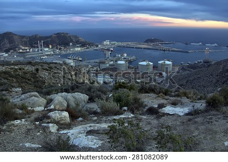 overview of a refinery with oil deposits in the evening - stock photo