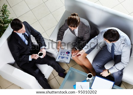 Overview of business team discussing the results of a new strategy - stock photo