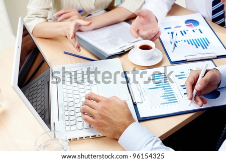 Overview of business team discussing the results of the strategic movement - stock photo