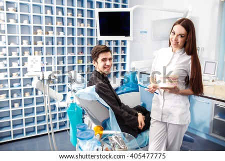 Overview of dental caries prevention.man at the dentist's chair during a dental procedure. Beautiful man smile close up. Healthy Smile. Beautiful male Smile - stock photo