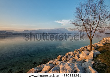 overview of Lake Garda at sunset with mountains behind