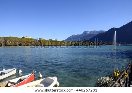 Overview of Lake of Annecy and boats in france - stock photo