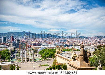 Overview of Les Quatres Columnes, the Four Columns, by Fountain and View of City and Surrounding Mountains on Bright Sunny Day, Barcelona, Spain - stock photo