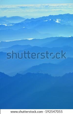 Overview of numerous mountain peak - stock photo