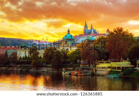 Overview of old Prague from Charles bridge side at sunset - stock photo