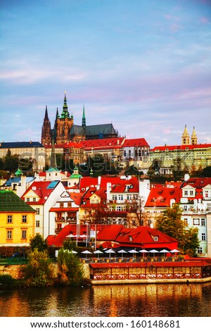 Overview of old Prague from Charles bridge side in the morning - stock photo