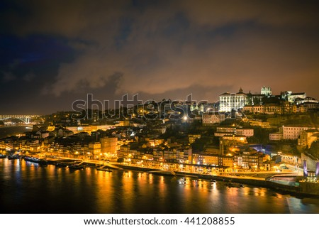 Overview of Old Town of Porto, Portugal at night. Ribeira and Douro river - stock photo