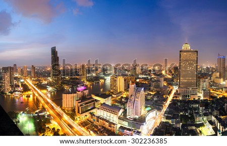Overview of one of the most important financial districts with bank headquarters, financial institutions and office buildings in Bangkok at sunset - stock photo