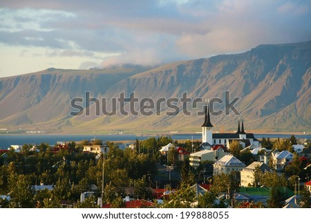 Overview of Reykjavik city with the Esja mountain range in the background, Iceland. - stock photo