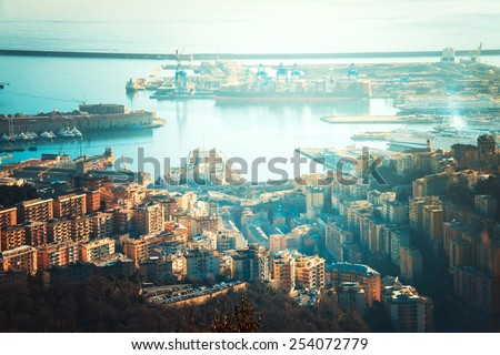 Overview of the ancient port in Genoa at evening, Liguria, Italy. Toned picture - stock photo
