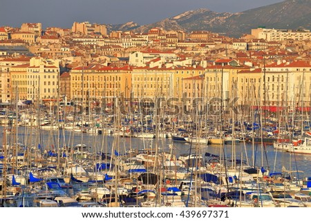 Overview to the harbor of Marseille and historical buildings nearby, France