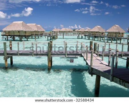 Overwater bungalows in Polynesia - stock photo
