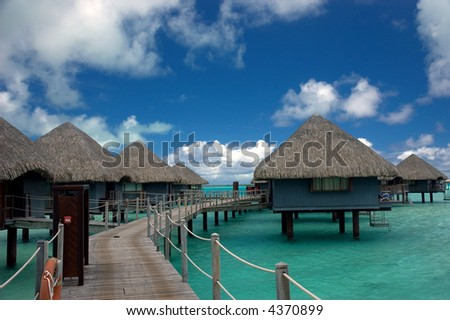 overwater bungalows in tropical island resort