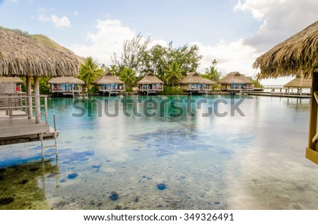 Overwater Bungalows on a tropical paradise beach in Moorea, French Polynesia - stock photo