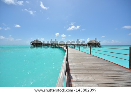Overwater villas on the tropical lagoon -- maldives tropical island resort  - stock photo