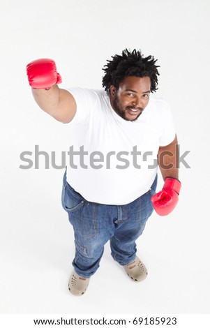 overweight african american man with boxing gloves - stock photo