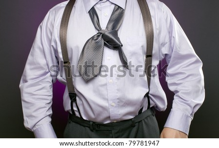 Overweight businessman with a bad knot in his necktie. Metaphor for incompetence, inability, or being unprepared. - stock photo