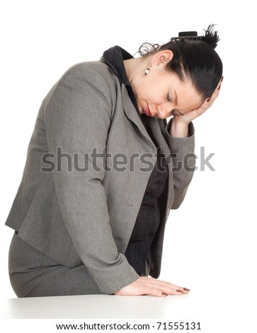 overweight businesswoman in grey suit suffering from pain, headache - stock photo