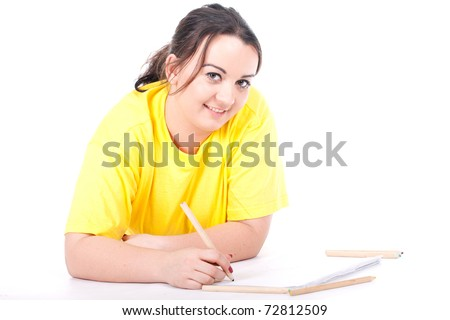 overweight, fat  woman in yellow shirt writing on blank card - stock photo