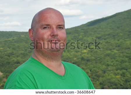 overweight male after hike up a forest mountain - stock photo
