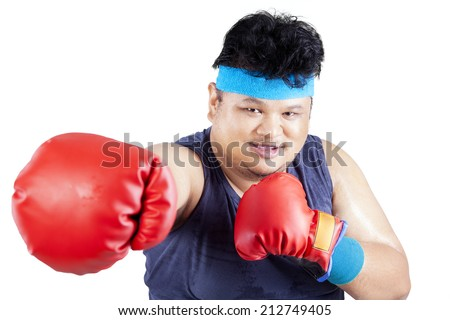 Overweight man exercise to lose weight by boxing. isolated on white background