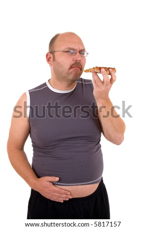 Overweight man holding his hand to his beer belly having eating too much pizza - stock photo