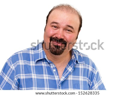 Overweight man with a goatee beard looking at the camera with an amused kindly expression isolated on white - stock photo