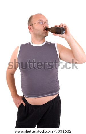 Overweight man with beerbelly having a sip from his beer - stock photo
