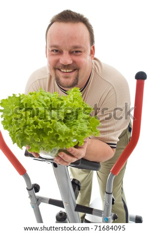 Overweight man with healthy lifestyle choices - exercising and eating fresh food, isolated - stock photo
