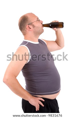 Overweight man with his beer belly sticking out drinking from his beerbottle - stock photo