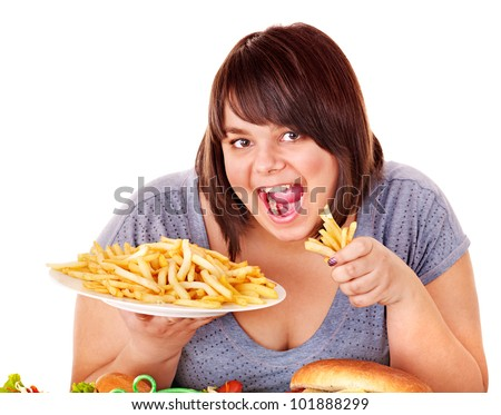 Overweight woman eating French fries. Isolated. - stock photo