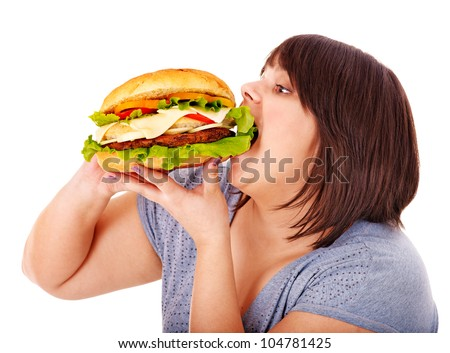 Overweight woman eating hamburger. Isolated.