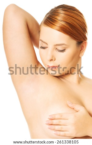 Overweight woman examining her breast. - stock photo