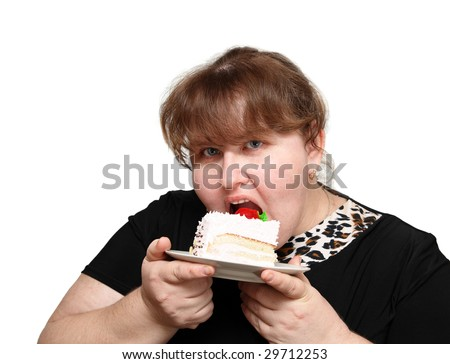 overweight woman greedy eating sweet cake - stock photo