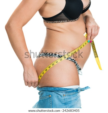 Overweight woman measuring her body isolated on white - stock photo