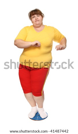 overweight woman on gymnastic disc isolated on white - stock photo