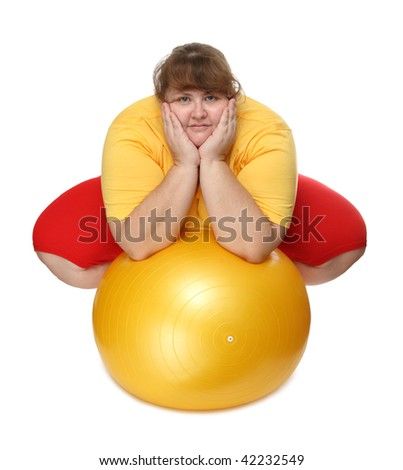 overweight woman sitting with gym ball on white - stock photo