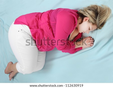Overweight woman sleeping. - stock photo