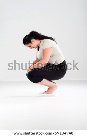 overweight woman standing on bathroom scale