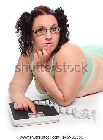 Overweight woman with a weighing machine.  - stock photo