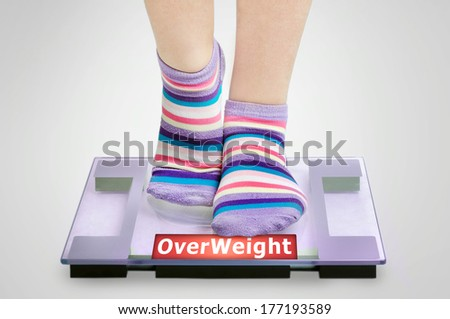 Overweight word on grey scales - stock photo