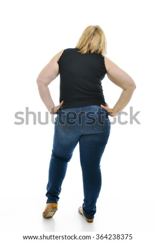 Overweight young woman, full length portrait, back view, over white background. - stock photo